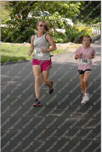 Me helping Callie to a 5K PR in May 2012